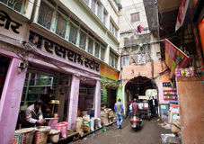 Private shops with food and spices on the narrow street Stock Images