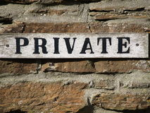 Private sign. A private sign attached to a brick wall Stock Photos