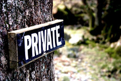 Private sign. On a tree Stock Images