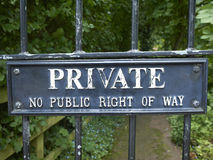 Private sign on gate UK. Private, No public right of way warning sign on metal gate or fence UK Royalty Free Stock Photography