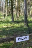 Private sign on gate in woodland setting. Stock Image
