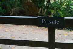 Private sign on gate in woodland setting. Stock Photos
