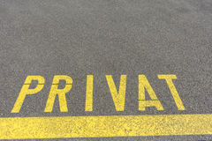 Private sign in german on concrete. In yellow Royalty Free Stock Photos
