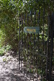 Private sign on a ornate iron gate. Stock Photo