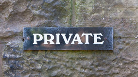 Private sign on a stone wall Royalty Free Stock Photos