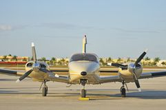 Private Small Airplane. Frontal view of airplane at private airport stock photos