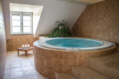 Private spa. Room with jacuzzi whirpool Royalty Free Stock Image