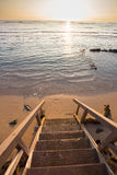 Private Stairway Beach Access in Hawaii. Private access to a public beach on Oahu Hawaii at sunset with the staircase in focus and the water blurred out Stock Photos