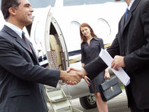 Private success. Business people working at private jet