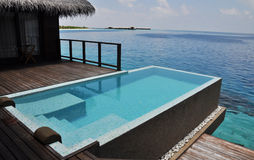 Private swimming pool. In a water villa Stock Photo