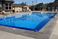 Private swimming pool. In new housing subdivision Stock Images