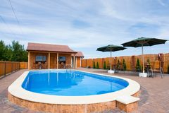 Private swimming pool. An outdoor private swimming pool within an enclosed fence Royalty Free Stock Image