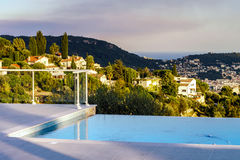 Private swimming pool. Modern villa. Royalty Free Stock Photography
