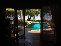 Private swimming pool at tropical villa royalty free stock images