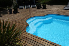 Private swimming pool with wooden floor Stock Photography