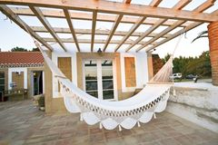 Private terrace with hammock. For leisure times Royalty Free Stock Photography