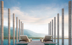Private terrace on swimming pool with mountain view 3d rendering image. There are border less swimming pool decorate with stone column and surrounding with Stock Photos