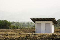 Private toilet cabin in the bare land, Thailand Stock Photo