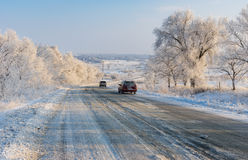 Private transport moving on a country slippery road at winter season Royalty Free Stock Photo
