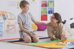Private tutor and child Stock Images
