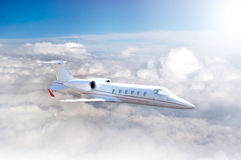 Private white Jet. In flight royalty free stock images