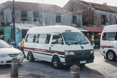 Private white mini buses parked at the outdoor bus terminal in Bridgetown, Barbados. royalty free stock image