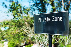 Private zone sign standing for restricted access Stock Photography