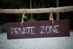 Private zone write on wood hanging rope at sea bea Royalty Free Stock Photos