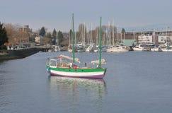 Privately Built Homemade Sailboat. A privately built sailboat anchored near a marina Royalty Free Stock Images