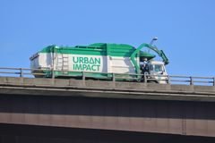Privately Owned Recycling Company. Urban Impact, a privately owned waste disposal company specializing in recycling, crosses the Oak Street Bridge in Vancouver stock images