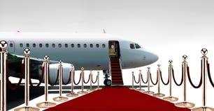 Privater Flugzeugeinstieg auf rotem Teppich Stockbilder