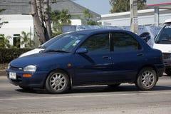 Privates kleines altes Auto, Mazda 121 Lizenzfreies Stockfoto