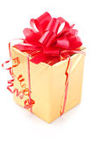 Prize and gift. Prize a gift with a red tape in a gold wrapper close up Royalty Free Stock Photography