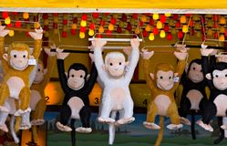 Prize Monkeys. At a game of chance on a seaside boardwalk Royalty Free Stock Images