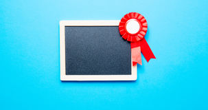 Prize ribbon and blackboard Stock Photography