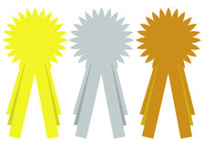 Prize ribbon rosettes. A set of three isolated ribbons or rosettes in gold, silver and bronze representing first, second and third prize with blank copy-space Stock Photo