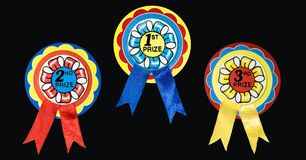 Prize ribbons. For first, second and third place. Isolated on black stock photos