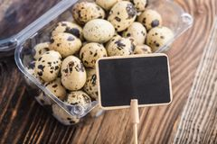 prize tag with quail eggs stock images