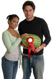 Prize Winner. A young couple holding a prize winning watermelon stock photo
