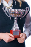 Prize-winning cup in hands of a command royalty free stock photography