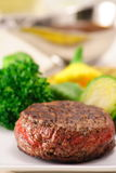 Prized cut fillet mignon. Incredible grilled to perfection fine gourmet  fillet mignon with steamed vegetables Royalty Free Stock Images
