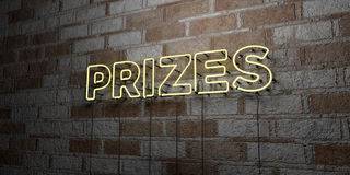 PRIZES - Glowing Neon Sign on stonework wall - 3D rendered royalty free stock illustration. Can be used for online banner ads and direct mailers Royalty Free Stock Photo