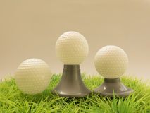 Prizes in Golf, balls with different tee Stock Image