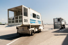 PRM passenger mobility assistance vehicle at airport runway. Airport passenger mobility assistance vehicle, also known as PRM,  is seen standing in stand by at Royalty Free Stock Photos