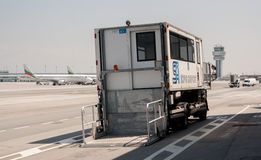 PRM passenger mobility assistance vehicle at airport runway. Airport passenger mobility assistance vehicle, also known as PRM,  is seen standing in stand by at Stock Photo