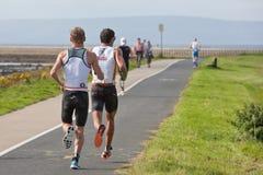 Pro athletes T. Bozzone (14) and  Jan Van Berk Royalty Free Stock Photo