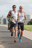 Pro atleti T. Bozzone (14) e gennaio Van Berk Fotografie Stock