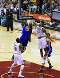 Pro basketball dunk. Golden State Warriors player dunks the basketball against the Cleveland Cavaliers in a National Basketball Association (NBA) pro basketball Stock Photos