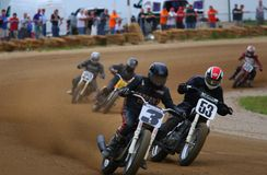 Pro Bike Race. Multiple motorcycles fight for the lead at the race royalty free stock photography