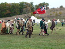 Pro British Colonists-Trail of History. McHenry County's Trail of History reenactment of pro-British colonists marching with British flag across Midwestern Stock Photography